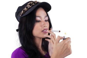 Trendy teenage girl smoking cigarette