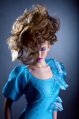 Woman with creative hairdo looking at camera