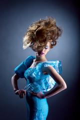 Creative model posing in blue dress