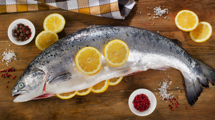 Atlantic Salmon  with lemon on  wooden table.