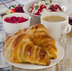 Fresh Croissants and cup of coffee for  breakfast