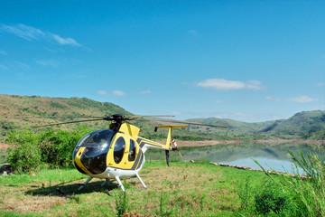 Yellow helicopter on lake island