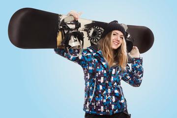 beautiful woman with a snowboard in studio