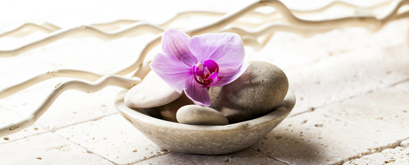symbols of purity with stones and pebbles in cup