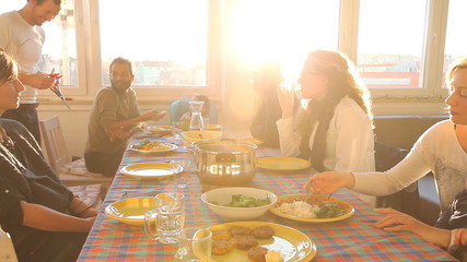 Group of friends eating lunch at home