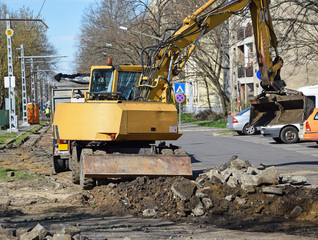 Excavator is working at the road construction