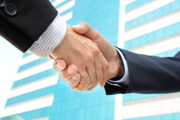 Handshake of businessmen - greeting, dealing, M & A concepts