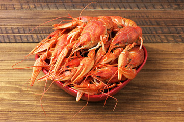Tasty boiled fresh crayfishes on a red bowl