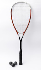 Squash racket isolated on white with balls