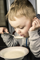 boy eats porridge