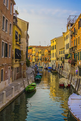 yellow sunset on the canal in Venice