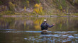 Leinwandbild Motiv Fly fisherman flyfishing in river