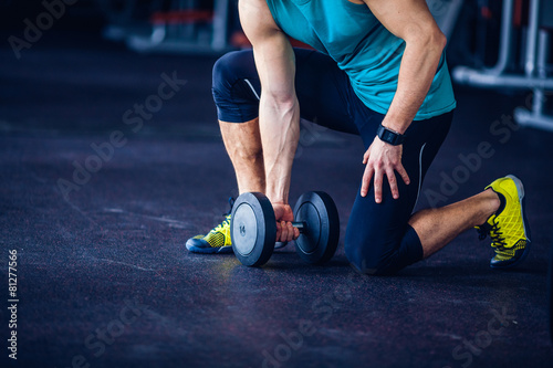 Tuinposter Gymnastiek Crossfit instructor at the gym doing Exercise
