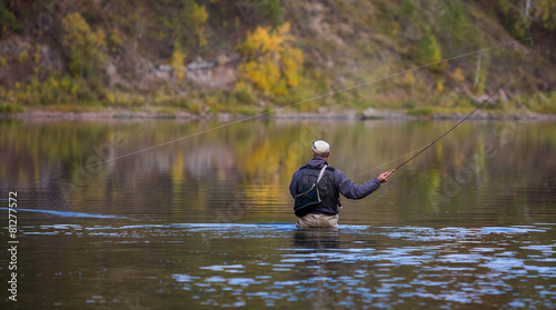 Tuinposter Vissen Fly fisherman flyfishing in river