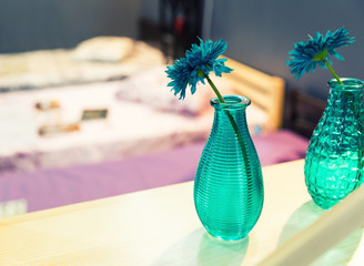 Vase of blue flower with colorful interior