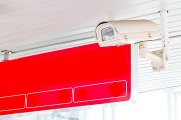 CCTV sercurity hanging from the ceiling with Red color of sign b