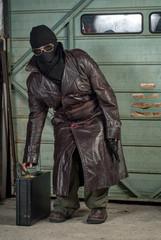 Spy or Terrorist in Ski Mask with Briefcase