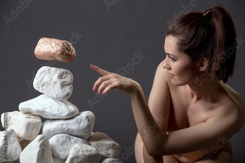 Naked girl moves stone without touching it - 81280110