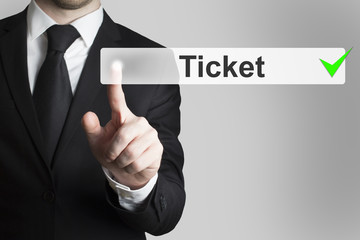 businessman pushing button ticket