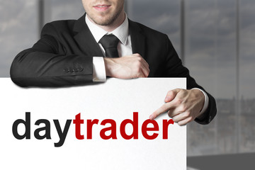 businessman pointing on sign daytrader