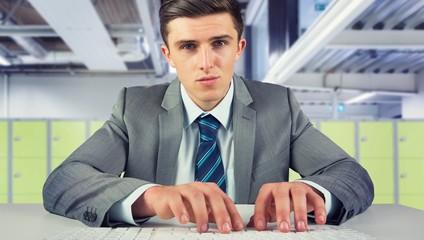 Composite image of serious businessman