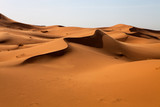large dunes in the Sahara deformed by the wind, Morocco