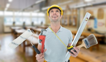 worker holding various equipment over white background