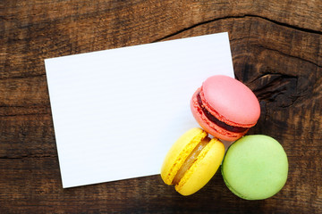 White greeting card with assorted colourful French macarons