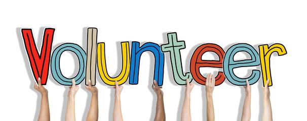 Group Hands Holding Letter Volunteer Concept