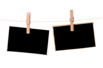 Blank photos hanging on a clothesline