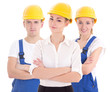 team work concept - two young women and man in blue builder 's u