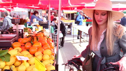 Pretty girl is walking at the market
