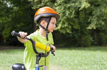 Child cyclist in park