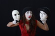 the girl is MIME holding a theatrical mask in hats - 81287778