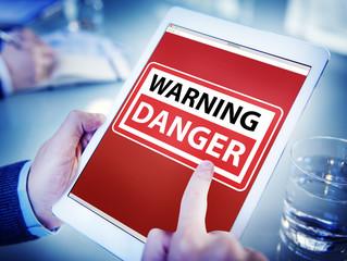 Hands Holding Digital Tablet Danger Concept