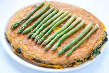 Egg omelet with spinach and asparagus