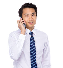 Young asian business man talking on mobile