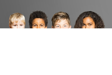 Childs behind white poster