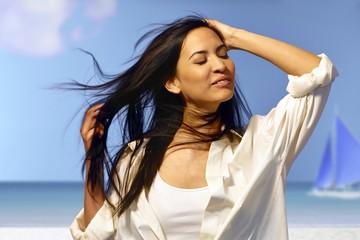 Beautiful woman enjoying summer sun
