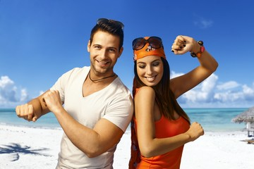 Young couple dancing on the beach