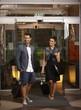 Happy couple entering hotel lobby