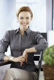 Young businesswoman smiling happy