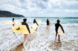 unidentified surfers with surfing boards - 81290577
