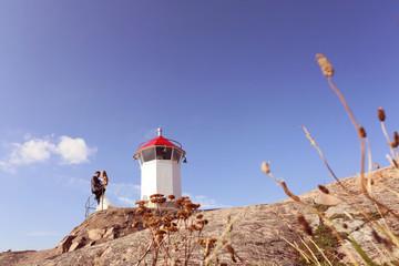 Bride and groom near lighthouse