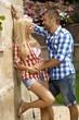Confident man dating young blonde girl outdoors