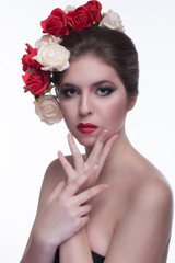 Model girl face with roses. Fashion portrait.