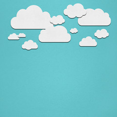 White clouds on a turquoise background