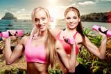 Girls doing fitness exercise with dumbbells