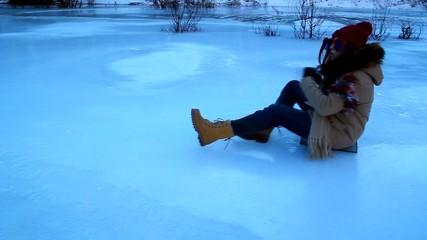 Funny girl in orange glasses riding on ice