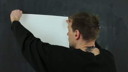 The artist sets the white canvas for painting